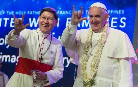 "Pope Francis with Archbishop Cardinal Tagle greet the crowd ""I Love You"" in sign-language (source: nydailynews.com)"